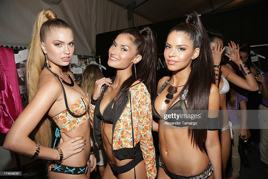 Models prepare backstage at the Beach Bunny show during MercedesBenz Fashion Week Swim 2014 at Cabana Grande at the Raleigh on July 19 2013 in Miami...