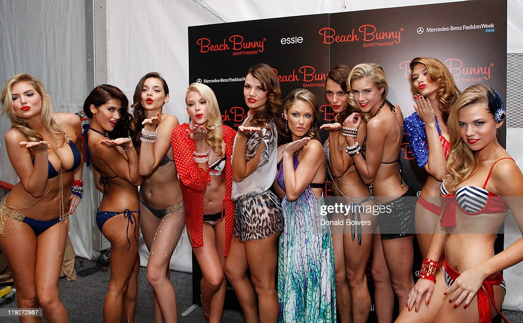 Models prepare backstage at the Beach Bunny Swimwear show during Mercedes-Benz Fashion Week Swim 2012 at The Raleigh on July 15, 2011 in Miami Beach, Florida.