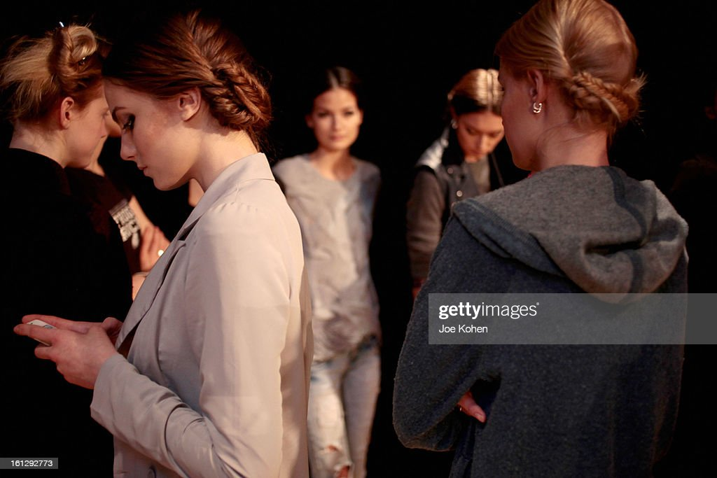Models prepare backstage at the Christian Siriano Fall 2013 fashion show during Mercedes-Benz Fashion Week on February 9, 2013 in New York City.