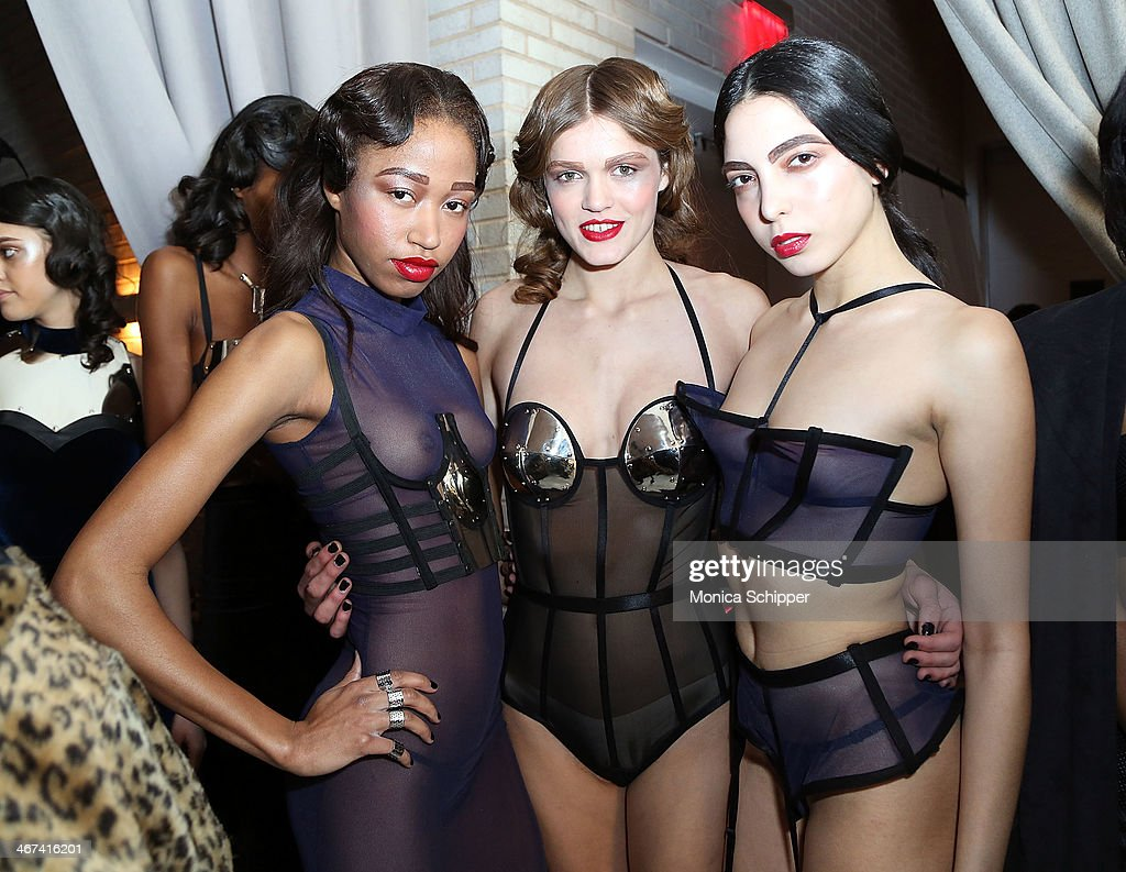 Models prepare backstage at the Chromat fashion show during MADE Fashion Week Fall 2014 at The Standard Hotel on February 6, 2014 in New York City.