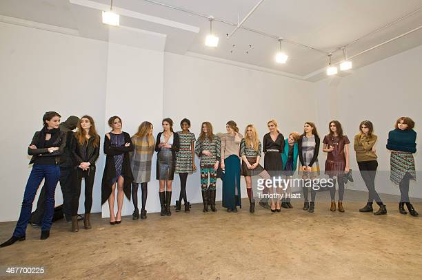 Models prepare backstage at the Harare presentation during MADE Fashion Week Fall 2014 at Highline Loft on February 7 2014 in New York City