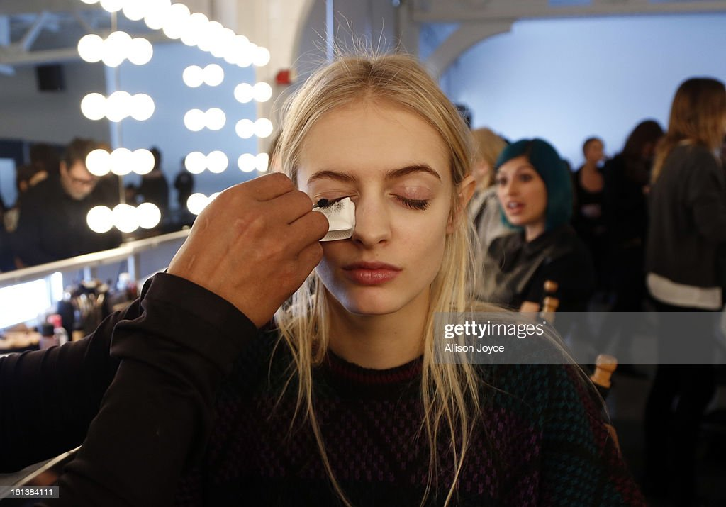 Models prepare backstage at the Jeremy Laing fall 2013 fashion show during Mercedes-Benz Fashion Week at Pier 59 on February 10, 2013 in New York City.