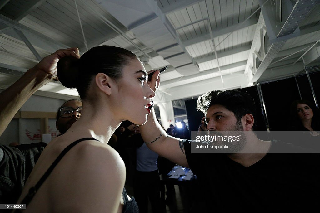 Models prepare backstage at the Malan Breton during Fall 2013 Mercedes-Benz Fashion Week at Pier 59 Studios on February 10, 2013 in New York City.