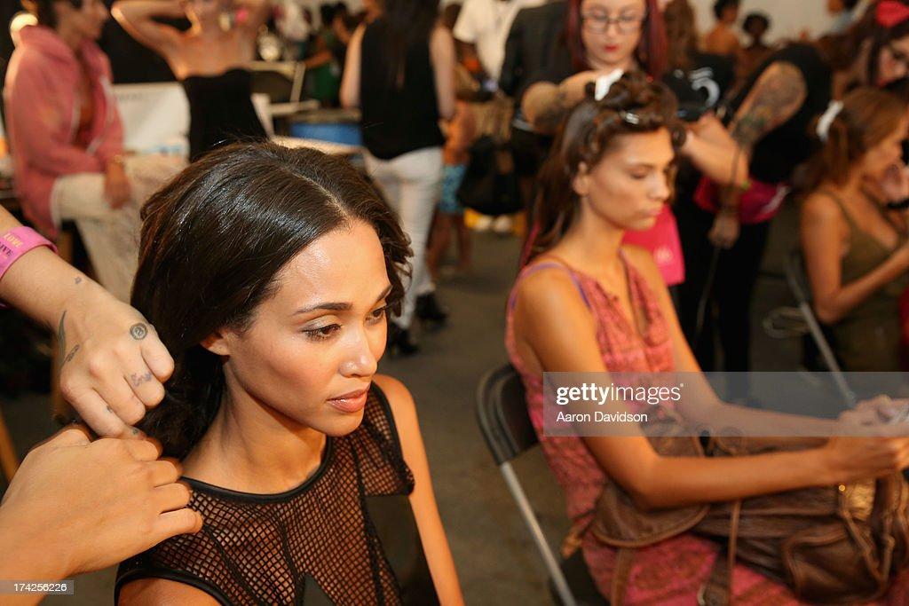 Models prepare backstage at the Naila/ Sauvage/ Zingara Swimwear show At Mercedes-Benz Fashion Week Swim 2014 at Cabana Grande at the Raleigh on July 22, 2013 in Miami, Florida.