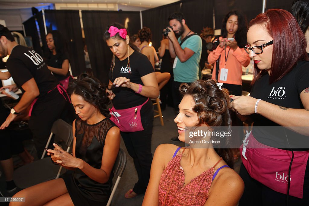 Models prepare backstage at the Naila/ Sauvage/ Zingara Swimwear show At Mercedes-Benz Fashion Week Swim 2014 at Cabana Grande at the Raleigh on July 22, 2013 in Miami, Florida.