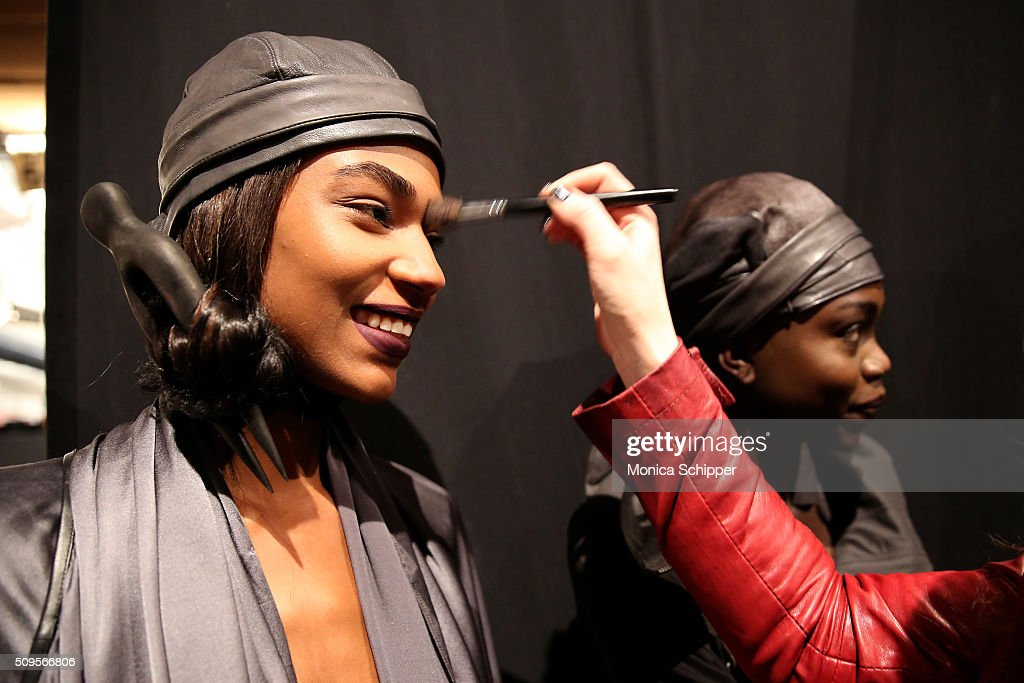 Models prepare backstage at the Nicholas K Fall 2016 fashion show during New York Fashion Week: The Shows at The Dock, Skylight at Moynihan Station on February 11, 2016 in New York City.