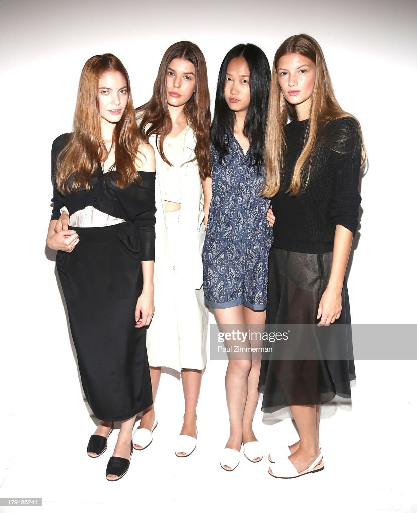 Models prepare backstage at the Organic By John Patrick show during Spring 2014 Mercedes-Benz Fashion Week on September 4, 2013 in New York City.