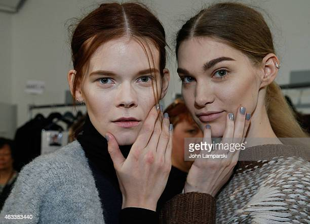 Models prepare backstage at the Sally LaPointe show during MercedesBenz Fashion Week Fall 2015 at Skylight Modern on February 13 2015 in New York City