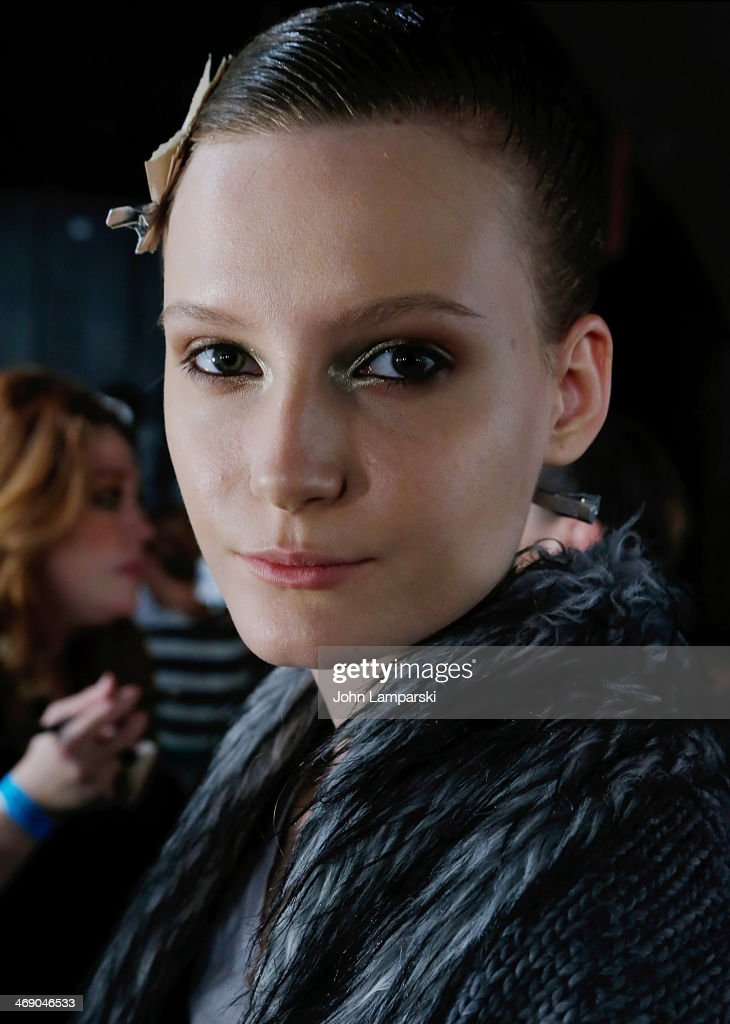 Models prepare backstage at the Sass & Bide Show during Mercedes-Benz Fashion Week Fall 2014 at Classic Car Club on February 12, 2014 in New York City.