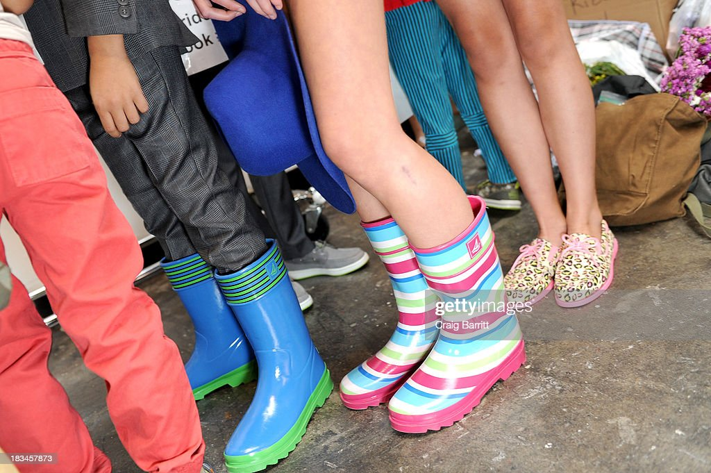 Models prepare backstage at the Stride Rite Children's Group Fashion Showcase at petitePARADE on October 6, 2013 at Industria Superstudios in New York City.