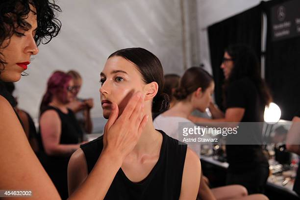 Models prepare backstage at the Tadashi Shoji fashion show during MercedesBenz Fashion Week Spring 2015 at The Salon at Lincoln Center on September 4...
