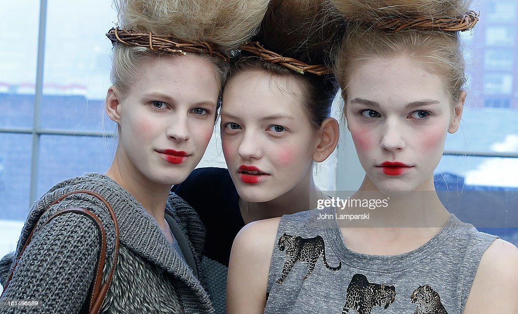 Models prepare backstage at the Thom Browne during Fall 2013 Mercedes-Benz Fashion Weekon February 11, 2013 in New York City.