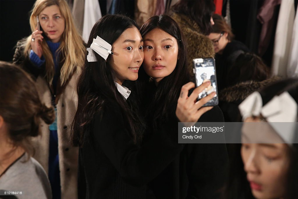 Models prepare backstage at the Tome Fall 2016 fashion show during New York Fashion Week: The Shows at The Dock, Skylight at Moynihan Station on February 14, 2016 in New York City.