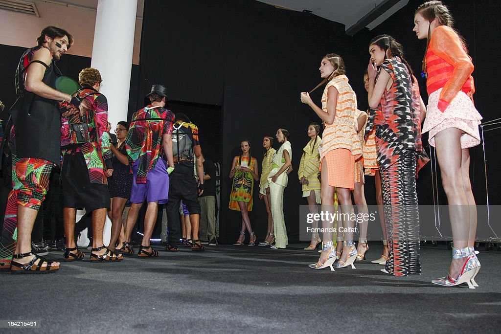 Models prepare backstage at the Triton show during Sao Paulo Fashion Week Summer 2013/2014 on March 20, 2013 in Sao Paulo, Brazil.