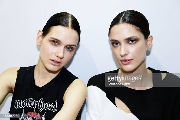 Models prepare backstage at the Victor Dzenk fashion show during Sao Paulo Fashion Week Winter 2015 at Parque Candido Portinari on November 3 2014 in...
