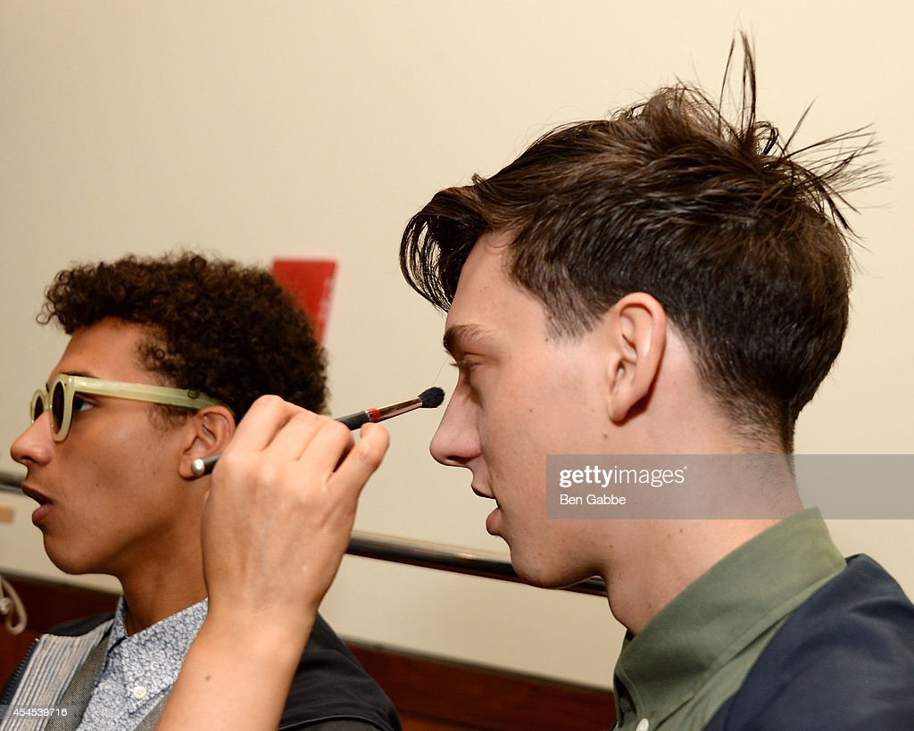 Models prepare backstage at Timo Weiland Men's during Mercedes-Benz Fashion Week Spring 2015 at The Highline Hotel on September 3, 2014 in New York City.