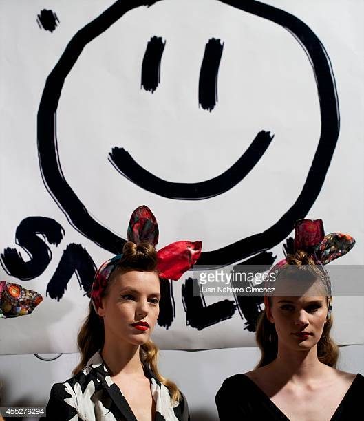 Models prepare backstage before a fashion show of Desigual during the Mercedes Benz Fashion Week Madrid S/S 2015 at Ifema on September 11 2014 in...