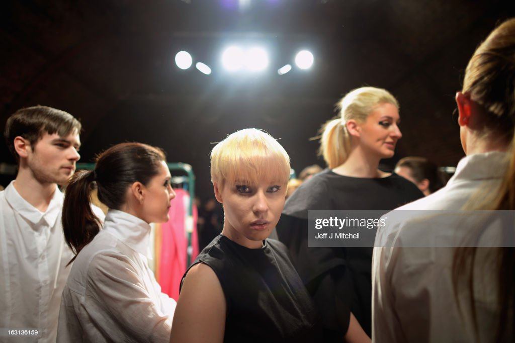 Models prepare backstage before taking part in the Glasgow School of Art Fashion show on March 5, 2013 in Glasgow, Scotland. Third year textiles and fashion students unveil their striking new collections showing contemporary applications of Harris Tweed, inspired by the designs created for the Ballets Russes' Rite of Spring. The Glasgow School of Art has produced some of the most celebrated designers of recent years, notably Jonathan Saunders..