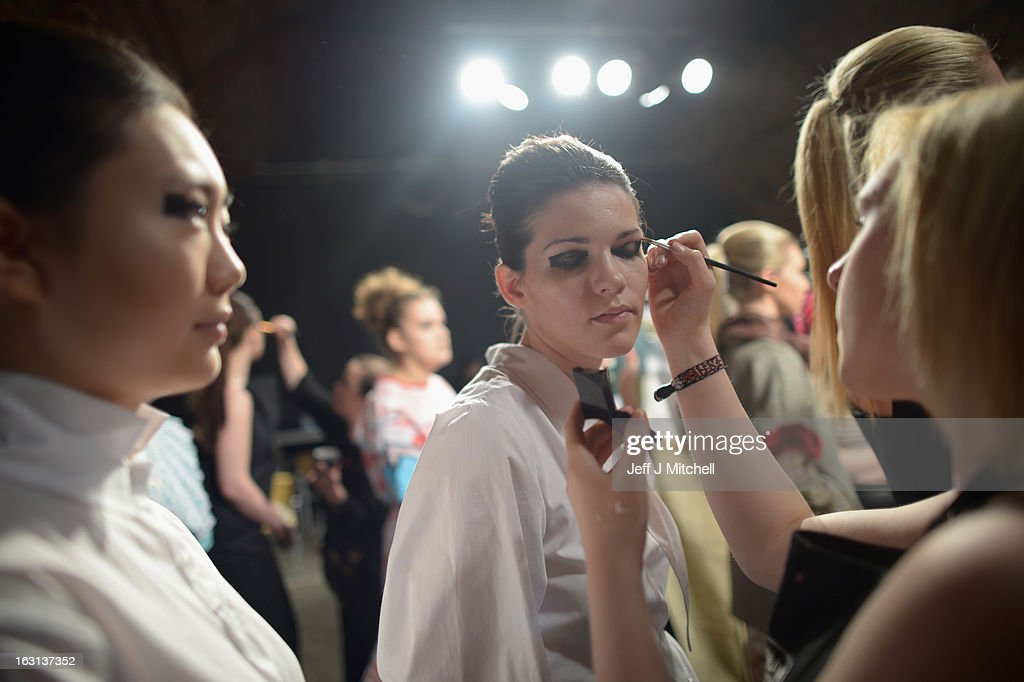 Models prepare backstage before taking part in the Glasgow School of Art Fashion show on March 5, 2013 in Glasgow, Scotland. Third year textiles and fashion students unveil their striking new collections showing contemporary applications of Harris Tweed, inspired by the designs created for the Ballets Russes' Rite of Spring. The Glasgow School of Art has produced some of the most celebrated designers of recent years, notably Jonathan Saunders.