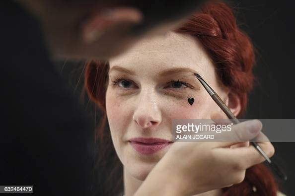 Models prepare backstage before the French Lingerie Show 'Lingerie Mon Amour' by Lingerie Francaise in Paris on January 22 2017 The French lingerie...