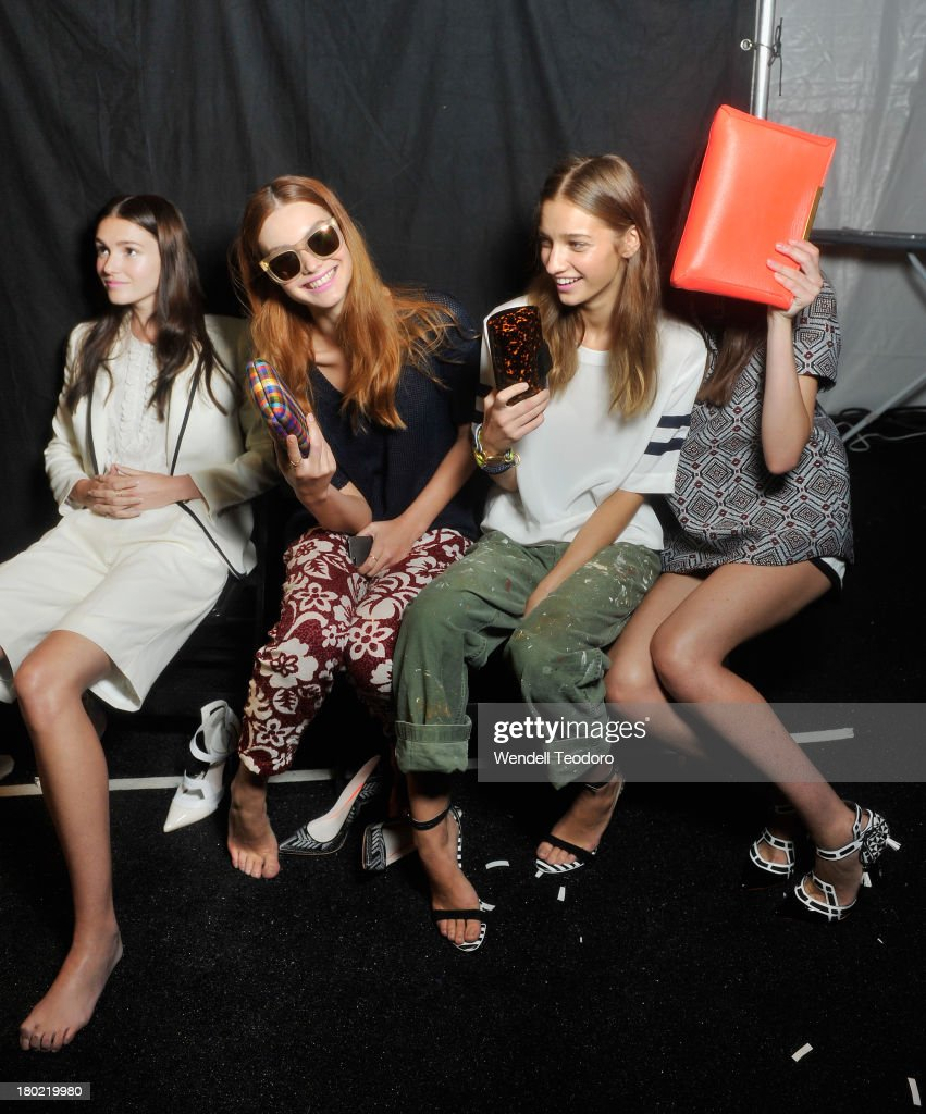 Models prepare backstage before the J.Crew presentation during Spring 2014 Mercedes-Benz Fashion Week at The Studio at Lincoln Center on September 10, 2013 in New York City.