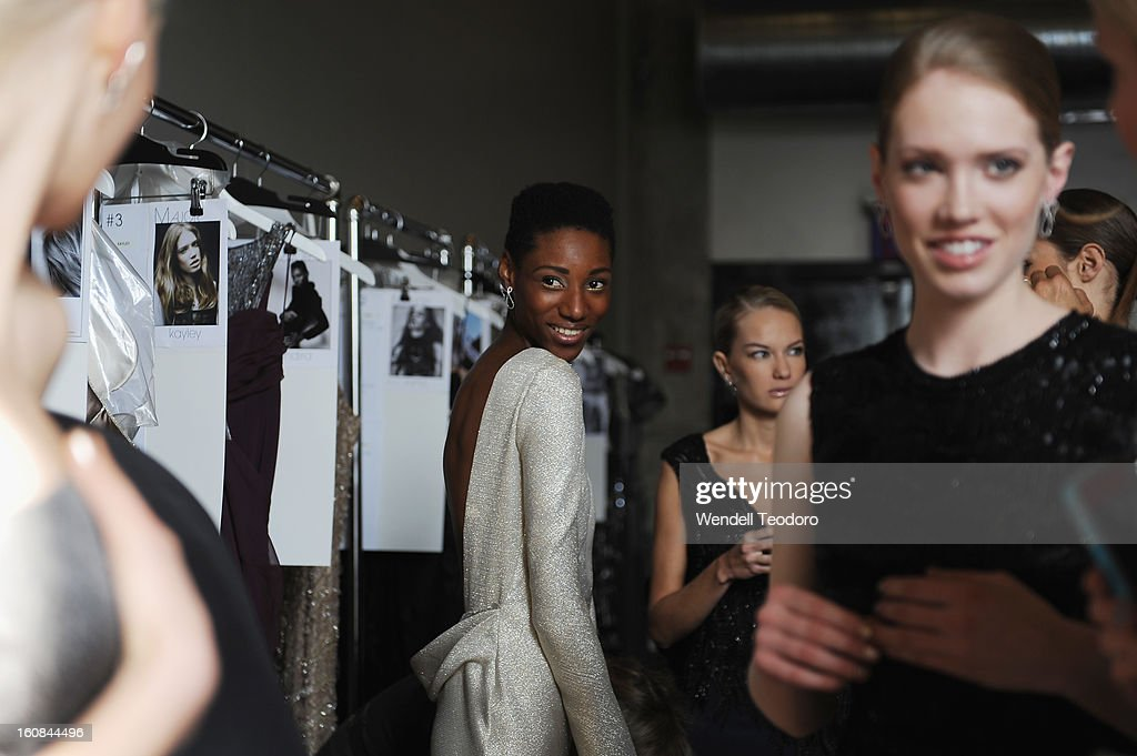 Models prepare backstage before the Rita Vinieris Debut Eveningwear Collection presentation during Fall 2013 Mercedes-Benz Fashion Week at the Baryshnikov Arts Center on February 6, 2013 in New York City.