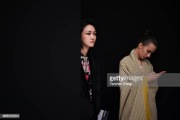 Models prepare backstage before the TONGRENTANG by ELau Collection show during the MercedesBenz China Fashion Week Spring/Summer 2018 Collection at...