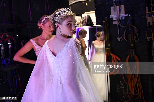 Models prepare backstage during 2016 Alfred Angelo Disney Fairy Tale Weddings Bridal Collection fashion show debut at New Amsterdam Theatre on...