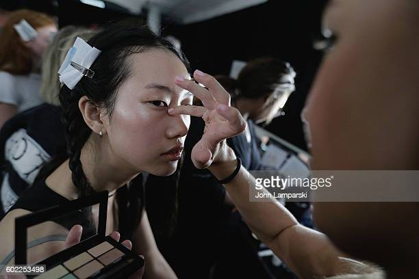Models prepare backstage during Band Of Outsiders show on September 2016 New York Fashion Week The Shows at The Gallery Skylight at Clarkson Sq on...