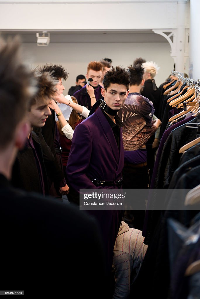 Models prepare backstage during the Alibellus + Men Autumn / Winter 2013 show as part of Paris Fashion Week at Maison des Metallos on January 16, 2013 in Paris, France.
