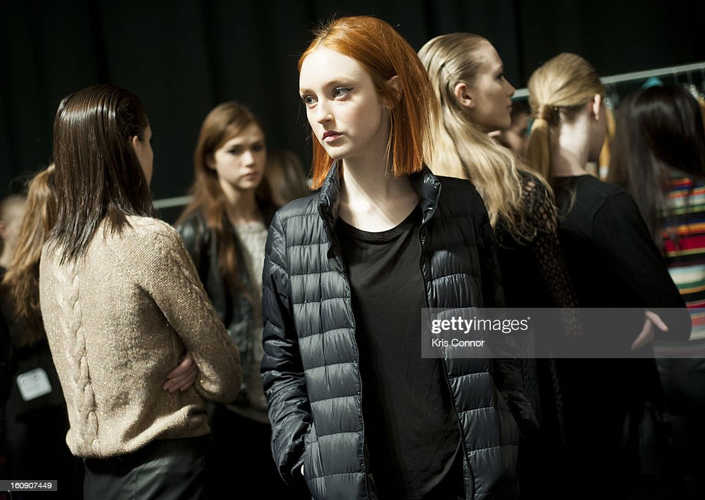 Models prepare backstage during the Concept Korea Fall 2013 Mercedes-Benz Fashion Show at The Stage at Lincoln Center on February 7, 2013 in New York City.