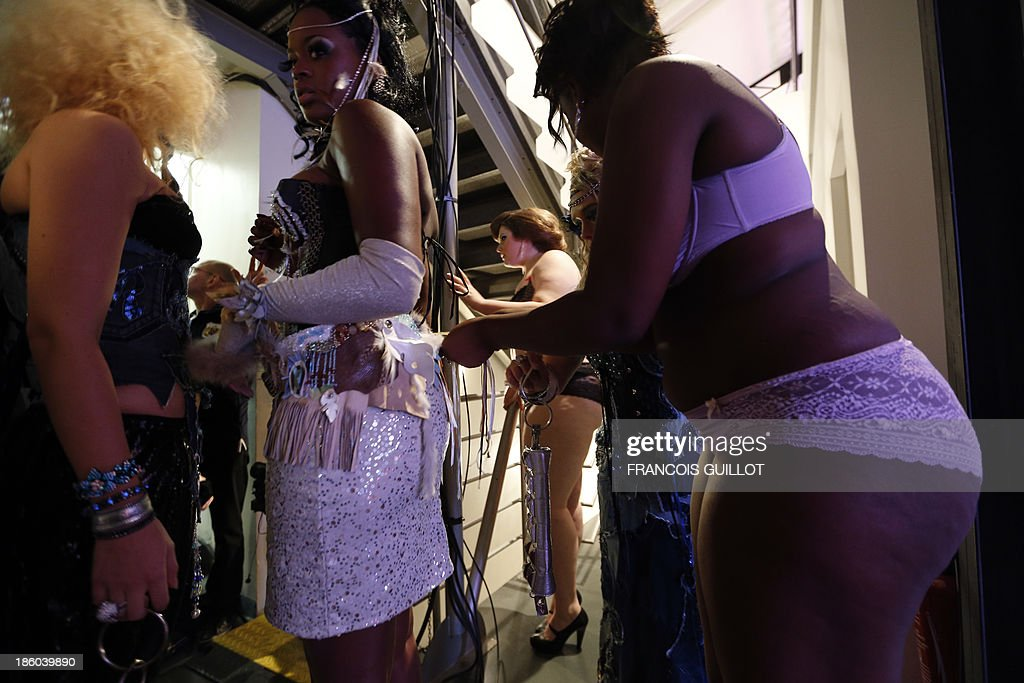 Models prepare backstage during the first Pulp fashion week, on October 27, 2013 in Paris. AFP PHOTO / FRANCOIS GUILLOT
