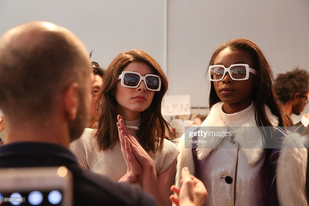 Models prepare backstage for the Custo Barcelona show during Fall 2016 New York Fashion Week at Pier 59 Studios on February 14, 2016 in New York City.
