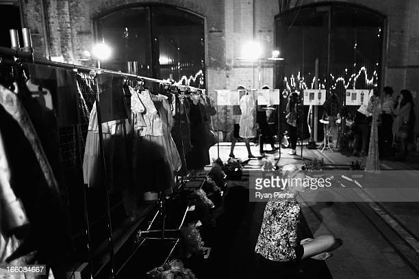 Models prepare backstage for the Romance Was Born show during MercedesBenz Fashion Week Australia Spring/Summer 2013/14 at Carriageworks on April 8...