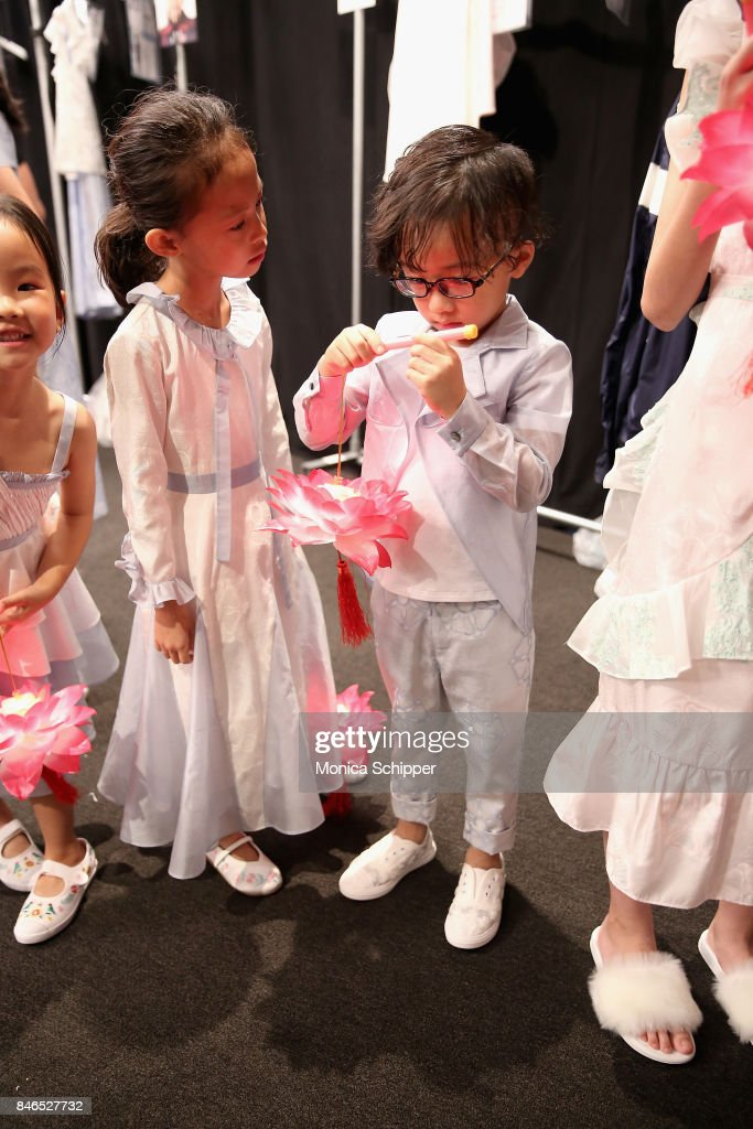 Models prepare backstage for the Vicky Zhang fashion show during New York Fashion Week: The Shows at Gallery 1, Skylight Clarkson Sq on September 13, 2017 in New York City.