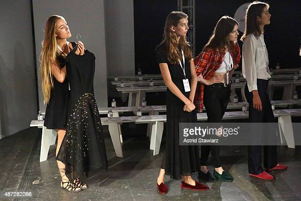 Models prepare backstage with the Google Made With Code LED dress at the ZAC Zac Posen SS16 NYFW show in partnership with Google Made With Code at...