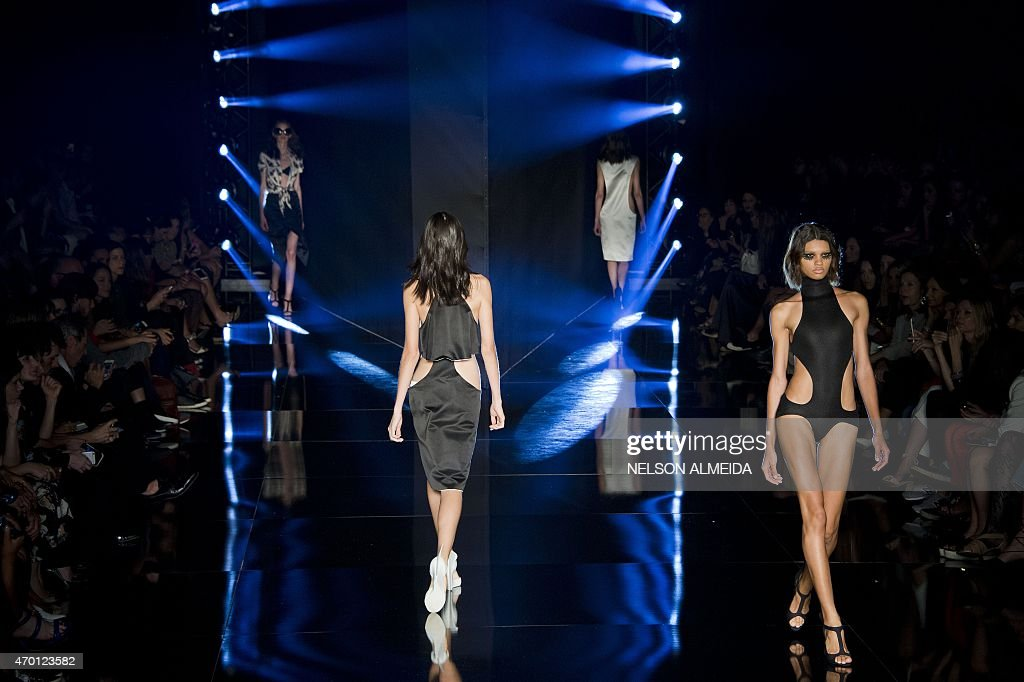 Models present a creation by Adriana Degreas during the 2016 Summer collections of the Sao Paulo Fashion Week in Sao Paulo Brazil on April 17 2015...