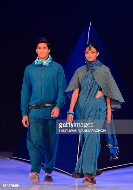 Models present a creation by fashion designer Bibi Russell at the Colombo fashion week in Colombo on March 17 2017 / AFP PHOTO / LAKRUWAN...
