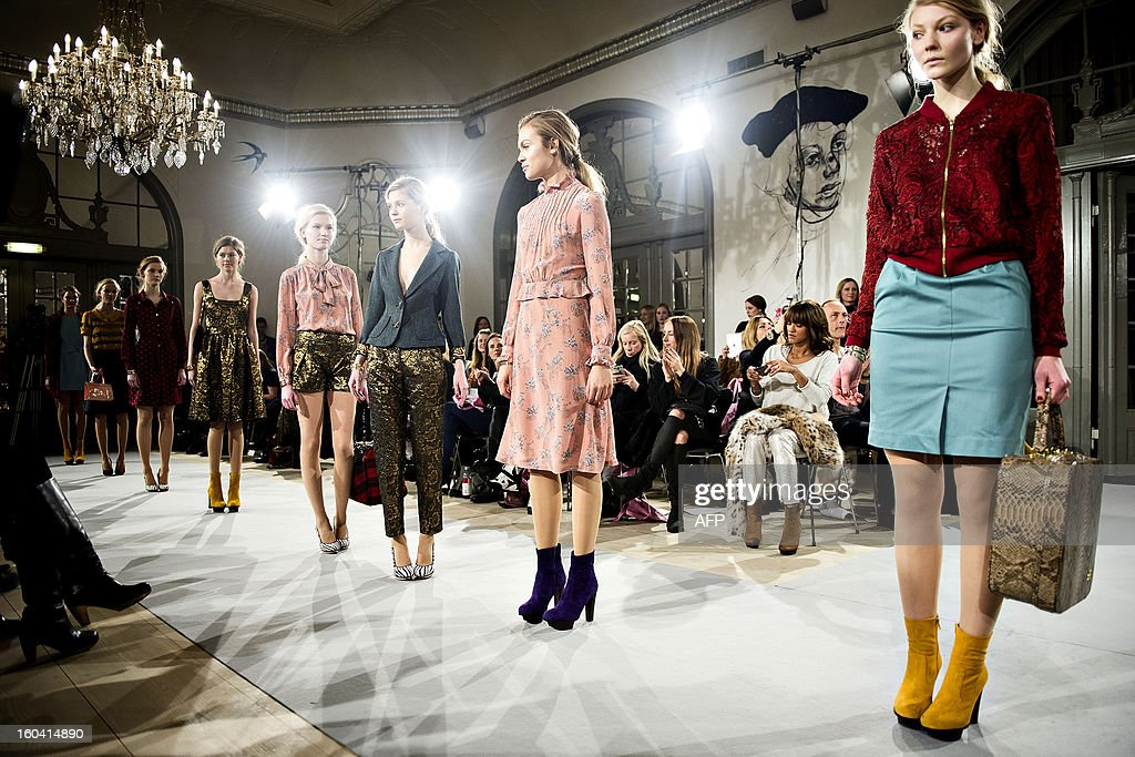 Models present a creation of Danish fashion house Edith & Ella Spring/Summer 2013 collection at the Hotel Nimb during the Copenhagen Fashion Week 2013, in Copenhagen, Denmark, on January 30, 2013. AFP PHOTO / SCANPIX/TORKIL ADSERSEN DENMARK OUT