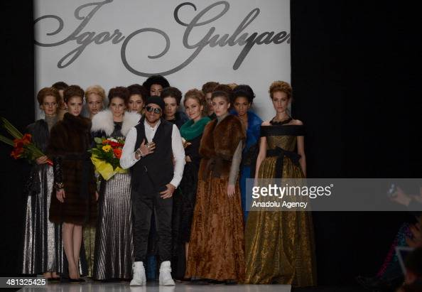 Models present a creation of Igor Gulyaev's 'MercedesBenz Presents' collection for 2014/2014 AutumnWinter during the MercedesBenz Fashion Week Russia...