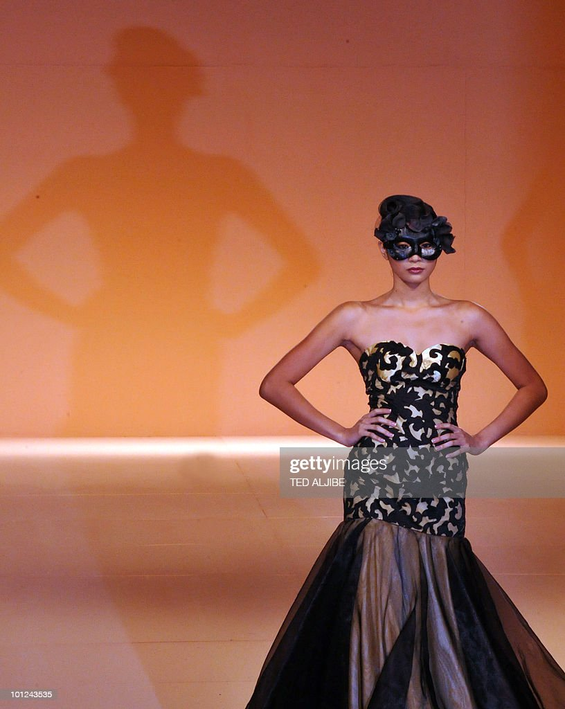 Models present a creations by Philippine designer Catherine Cavilte during the Philippine Fashion week in Manila on May 28, 2010. The Philippine fashion show is being held from May 27 to June 1, 2010.