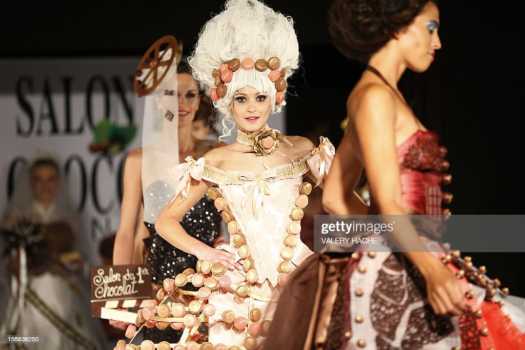 Models present a dress made of chocolate on November 22, 2012 in Cannes, Southeastern France, during a fashion show for the inauguration of Cannes international chocolate fair. The event runs until November 25, 2012.