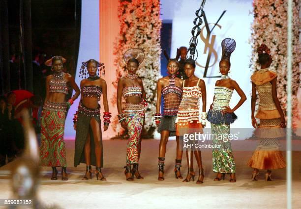 Models present Africaninspired creations for French designer Yves Saint Laurent 22 January 2002 during the retrospective part of Saint Laurent's last...