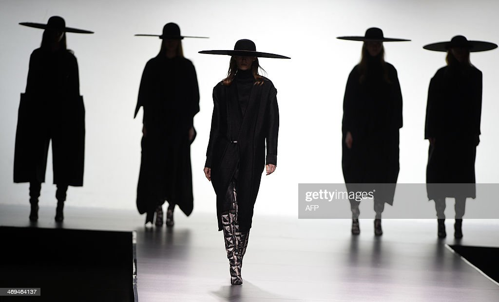 NAME - Models present Autumn/Winter 2014-2015 collection creations by Martin Lamothe during Madrid Fashion Week in Madrid on February 15, 2014.