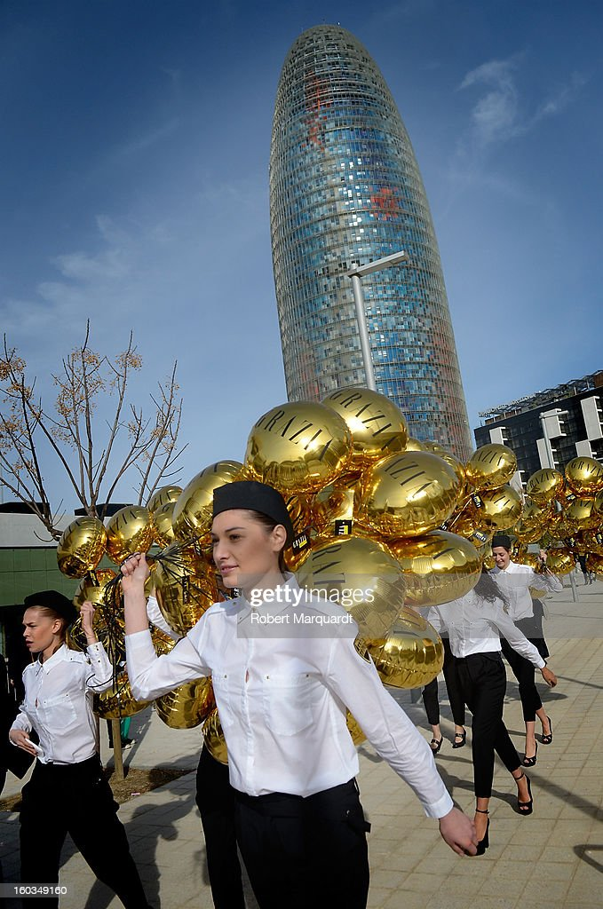 Models present balloons during the 080 Barcelona 'Autumn-Winter 2013-2014' fashion week in Barcelona on January 29, 2013 in Barcelona, Spain.