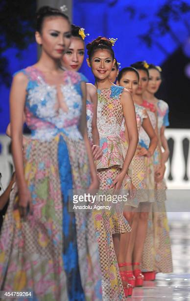 Models present costumes during the first day of the 6th Solo Batik Fashion in Surakarta Central Java Indonesia on September 05 2014