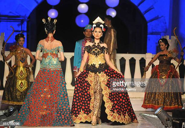 Models present costumes during the first day of the 6th Solo Batik Fashion Carnival in Surakarta Central Java Indonesia on September 05 2014