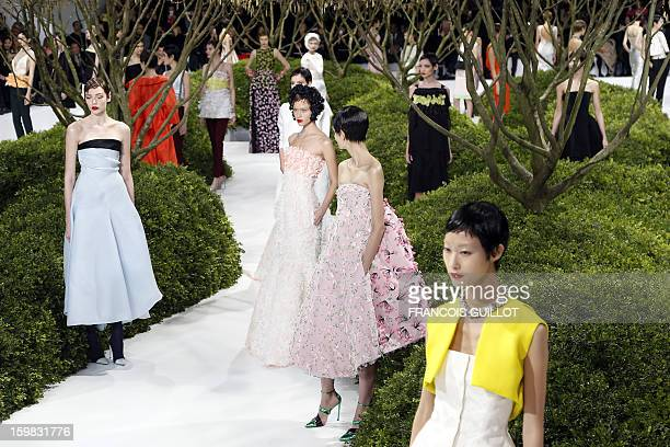 Models present creations by Belgian designer Raf Simons for Christian Dior during the Haute Couture SpringSummer 2013 collection shows on January 21...