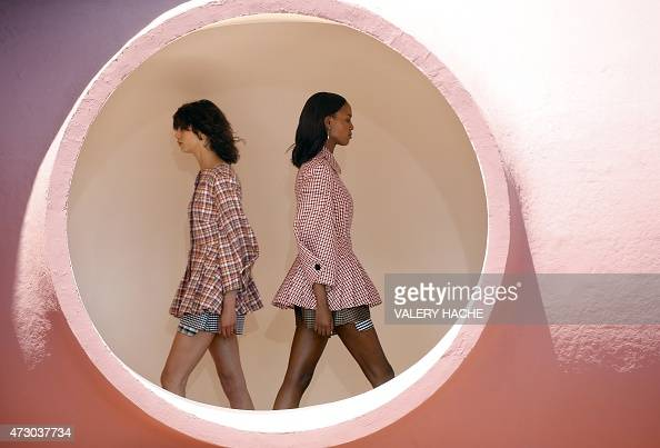 Models present creations by Belgian fashion designer Raf Simons during the Dior 2016 cruise collection show on May 11 2015 at the Palais Bulle in...