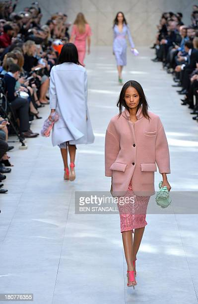 Models present creations by Burberry Prorsum during the 2014 Spring/Summer London Fashion Week in London on September 16 2013 AFP PHOTO / BEN STANSALL